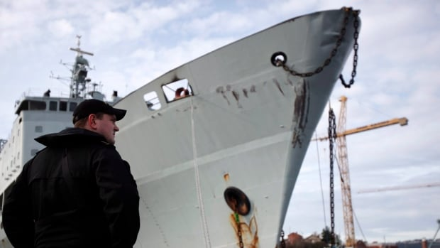 Royal Canadian Navy personnel watches over the HMCS Protecteur, a supply ship that was decommissioned last year. The Liberal budget tabled last week once again pushes funding for defence projects, such as new ships for the navy, down the road to when - hopefully - new ships are ready to require payment.