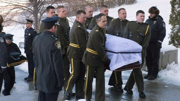 Surete du Quebec police officers carry the casket of police officer Thierry LeRoux  in Saguenay, Que.