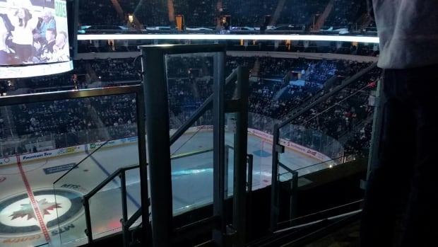 This is one of the views from Jared Funk's section at the MTS Centre. Jared and a group of wheelchair users sit in the accessible seating section in the upper bowl. Their view was good until a row of premium loge seats was added for the 2015/2016 Winnipeg Jets season.