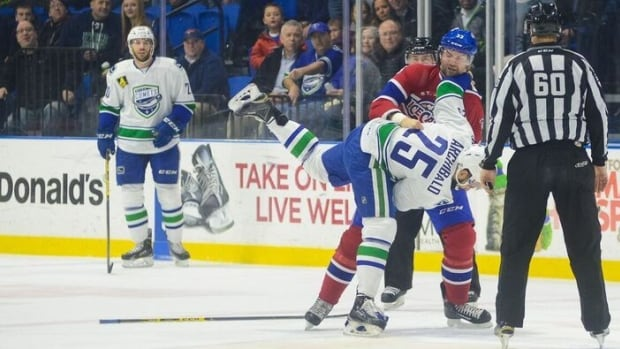 Fan favourite John Scott topples Darren Archibald in his first fight in a St. John's IceCaps uniform, during Friday's 4-1 loss to the Utica Comets.