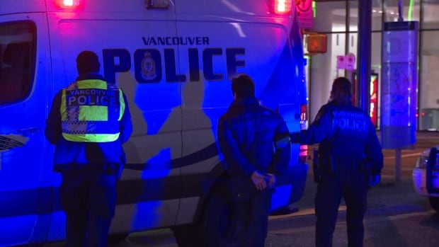 Vancouver Police took at least three people into custody after a stabbing on Granville Street early Saturday morning.