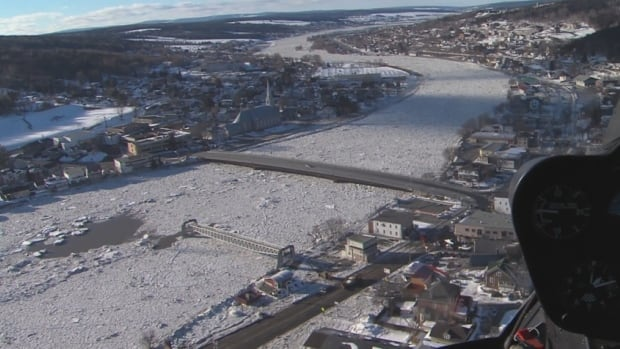 Firefighters continue to monitor the seven-kilometre ice barrier that's formed over the Chaudière River to make sure it doesn't start to overflow again.