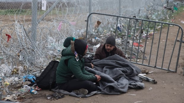 Asylum-seekers wait near the Idomeni border crossing in Greece near Macedonia.