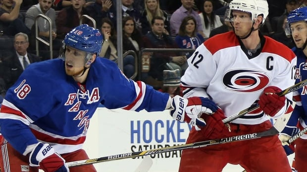 Eric Staal, right, no longer needs to worry about being defended by his brother Marc, left, after the Hurricanes traded Eric Staal to the Rangers on Sunday for two second-round draft picks and Finnish forward prospect Aleksi Saarela. Staal, 31, played his entire NHL career with Carolina and is eligible to become an unrestricted free agent on July 1.
