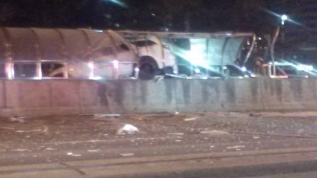 Four people have been rushed to hospital after a vehicle struck a bridge, rolled over and crashed into a glass pedestrian tunnel in Scarborough on Sunday night.