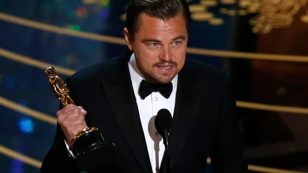 Leonardo DiCaprio holds the best actor Oscar for the movie The Revenant at the 88th Academy Awards in Hollywood.