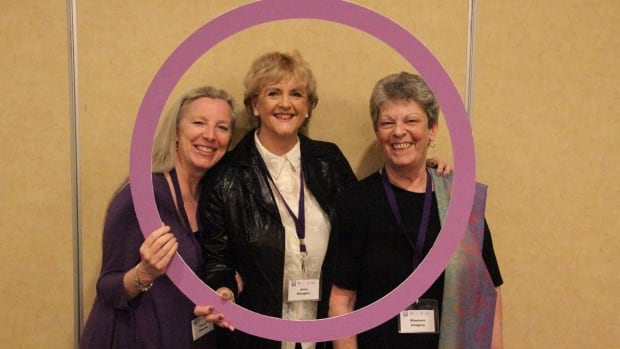 100 Women Who Care Winnipeg founder Jane Meagher, centre, poses with two of the original members.
