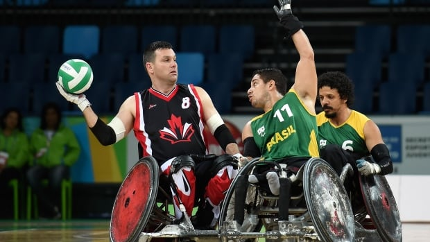 Micheal Whitehead of Canada (left) goes on offence against Brazil's Julio Cesar Braz during the International Wheelchair Rugby Championship - Aquece Rio Test Event for the Rio 2016 Paralympics. Canada beat Brazil 61 - 42, 53 - 40 in the teams' two match-ups.