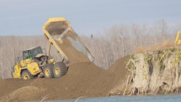 A series of failed berms in 2013 led to extra sediment flowing through the North Saskatchewan River, and the decline of fish stock, a scientist and fisherman say.