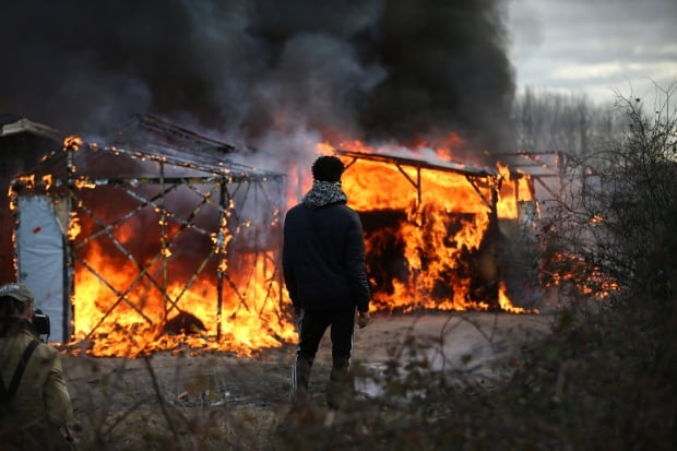Calais Jungle refugee camp removed Feb 29 2016 89524804 flaming huts