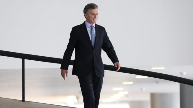 Argentina's President Mauricio Macri has signed a deal with holdout bondholders to pay 75 cents on the dollar.