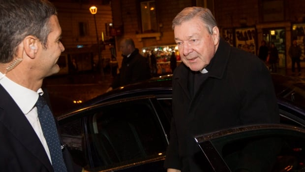 Australian Cardinal George Pell, right, arrives at the Quirinale hotel in Rome on Monday  to testify via videolink from the hotel to the Royal Commission sitting in Sydney.