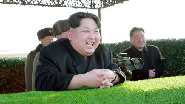 North Korean leader Kim Jong-un reacts during a test of an anti-tank guided weapon in this undated photo released by North Korea's Korean Central News Agency. The UN voted Wednesday to impose a new round of sanctions against North Korea.