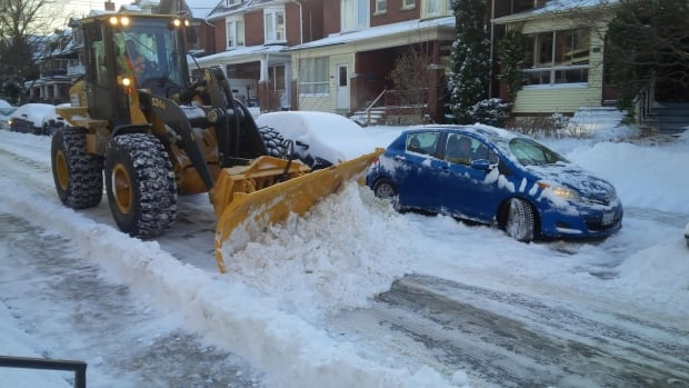 A plow clears snow from a side street in the Roncesvalles neighbourhood this morning. The storm dumped about 20 cm of snow across the Greater Toronto Area, making for a slower-than-usual morning commute.