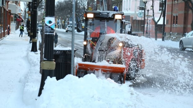 Snowblowers and snowplows were clearing streets and sidewalks in Hamilton on Tuesday morning after the city received a dump of snow on Monday and Tuesday.