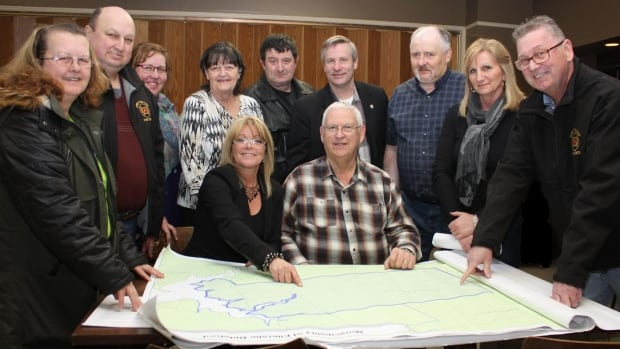 The Tyne Valley Fire District Joint Emergency Measures Organization Planning Committee with members of local councils, the Tyne Valley Fire Department and MLA Robert Henderson celebrate their new joint EMO plan.
