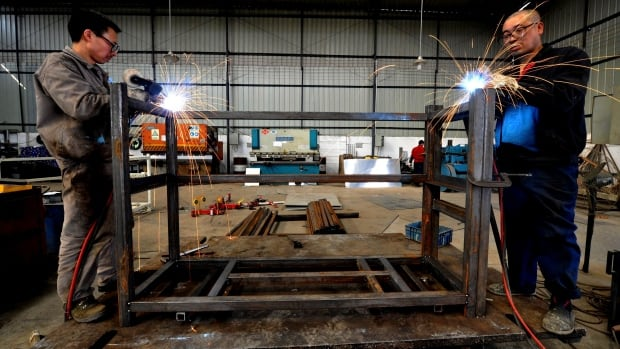 Workers weld steel frames for the Toyota Motor Corp. at a factory producing auto spare parts in Longquan in Chengdu in Sichuan province. Moody's has downgraded its outlook for China to negative, saying it has failed to carry out reforms.
