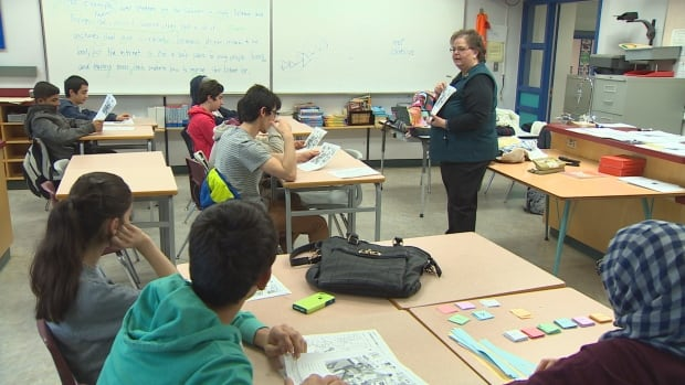 Patti Duggan volunteers her time to teach refugee high school students English.