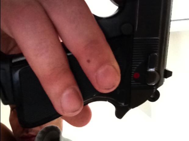 Man with gun Smich iPad