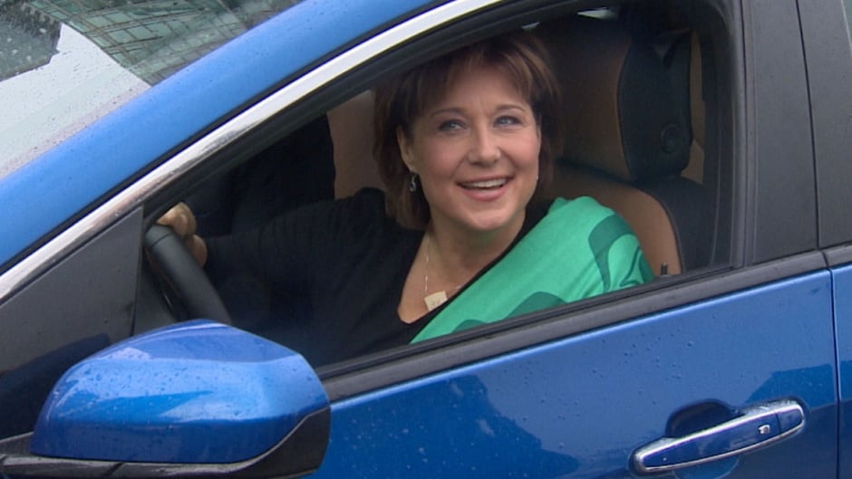 B.C. Premier Christy Clark arrives at an announcement about incentives for electric cars.