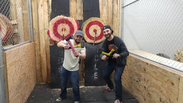 CBC columnist Chris Tse and Edmonton AM's traffic reporter Garrette McGowan gave axe-throwing a try.