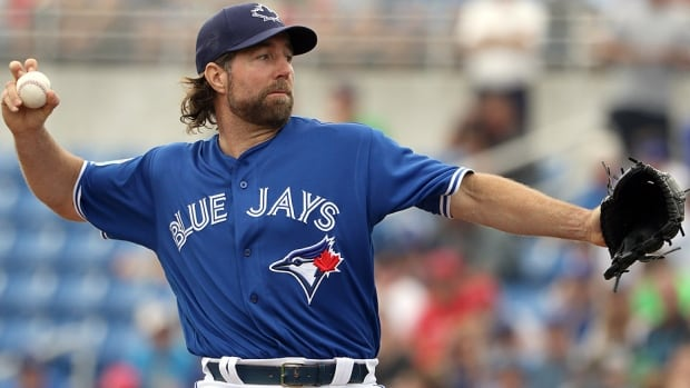 Blue Jays knuckleballer R.A. Dickey delivers in the first inning of Tuesday's spring training game against the Phillies in Dunedin, Fla. Dickey said his body felt great after the two-inning outing. The 41-year-old arrived at spring training following an off-season procedure on his right knee to remove part of his meniscus and smooth out some rough spots on Dickey's knee bone.