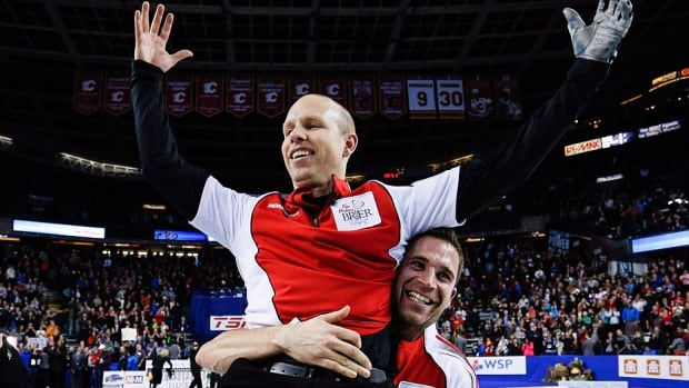 Team Canada skip Pat Simmons, left, is hoisted up by third John Morris as they celebrate defeating Northern Ontario to win the gold medal game at the 2015 Brier in Calgary. A stacked field for this year's event that begins Saturday in Ottawa includes reigning Olympic champion Brad Jacobs of Northern Ontario, two-time Brier champ Kevin Koe of Alberta and top-ranked Brad Gushue of Newfoundland and Labrador.