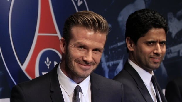 Nasser Al-Khelaifi, right, chair of BeIn Sports and owner of the Paris St Germain soccer team, appears with player David Beckham, left.  BeIn Media Group has just bought Miramax studios.