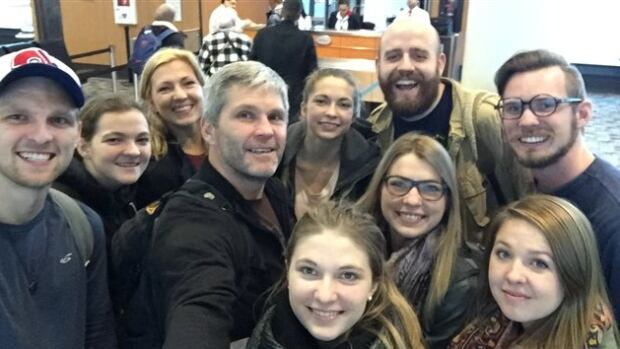 Paul McLean (centre) poses with his family on their way to Jordan to meet some of the refugees they're helping bring to Canada.
