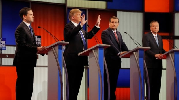 Republican U.S. presidential candidate Donald Trump displays his hands as rivals Marco Rubio, Ted Cruz and John Kasich look on during the U.S. Republican presidential candidates debate in Detroit. One of the unusual topics during this unusual campaign has been whether Trump's hands are small or not.