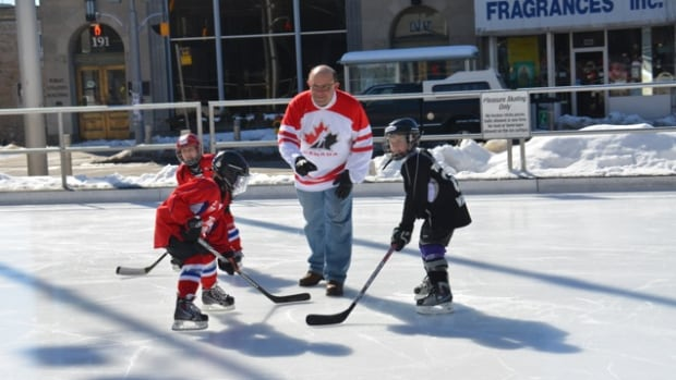 Kitchener Mayor Berry Vrbanovic drops the puck at a previous Mayor's Cup hockey tournament.