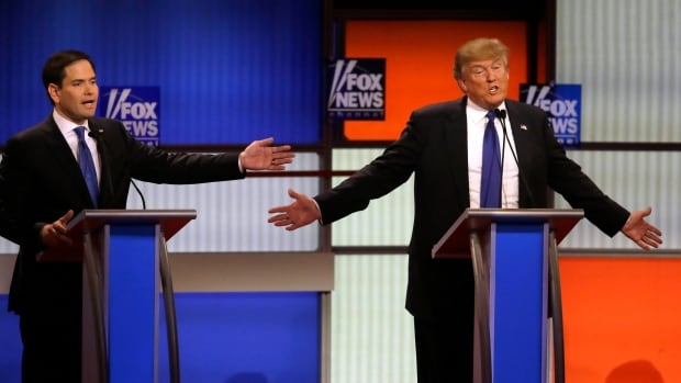 Republican presidential candidates Senator Marco Rubio and businessman Donald Trump argue a point during a Republican presidential primary debate at Fox Theatre Thursday in Detroit.