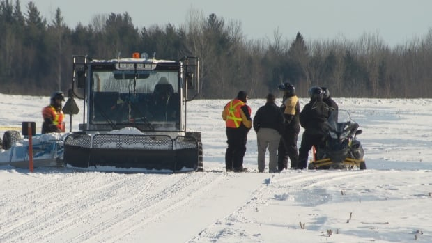 Investigators analyzed the scene of the fatal snowmobile crash on Thursday.