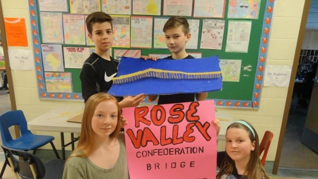 Sawyer (top right),Tristan, Zarya and Maddy of Rose Valley Elementary School show off their replica of the Confederation Bridge.