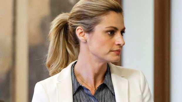 Sportscaster and television host Erin Andrews walks to the courtroom March 3 in Nashville. On Monday a jury awarded her $55 million in a lawsuit against the franchise owner and manager of a luxury hotel and a man who admitted to making secret nude recordings of her in 2008.