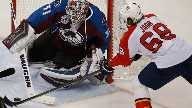 Avalanche goalie Calvin Pickard stops a shot off the stick of Panthers right-winger Jaromir Jagr in Thursday night's NHL game in Colorado. Jagr drew an assist on Florida's first goal for his 1,850th NHL point, tying him with Gordie Howe for third on the all-time list. Jagr's memorable night was bittersweet as the Panthers lost 3-2.