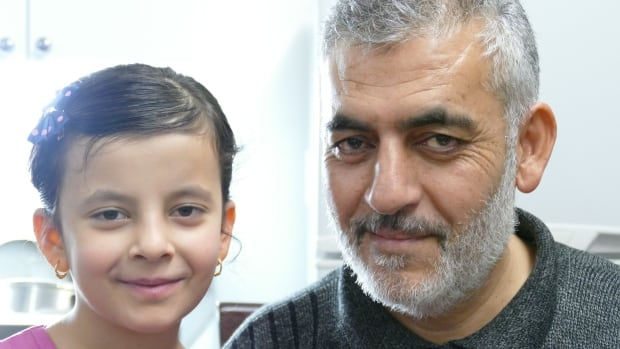 Esmaeel Al Meslamani with his seven-year-old daughter Duaa.