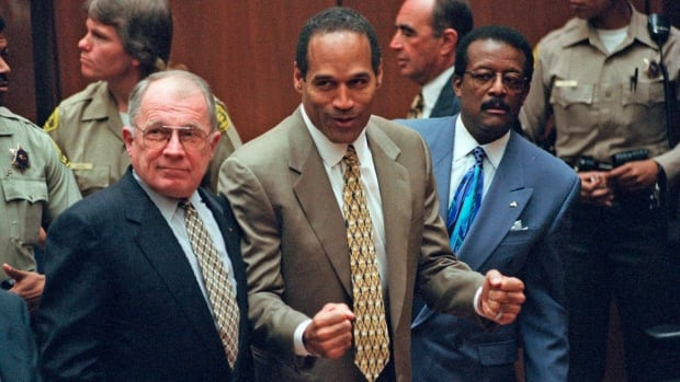 O.J. Simpson, centre, reacts as he is found not guilty of murdering his ex-wife, Nicole Brown Simpson, and her friend Ron Goldman on Oct. 3, 1995.