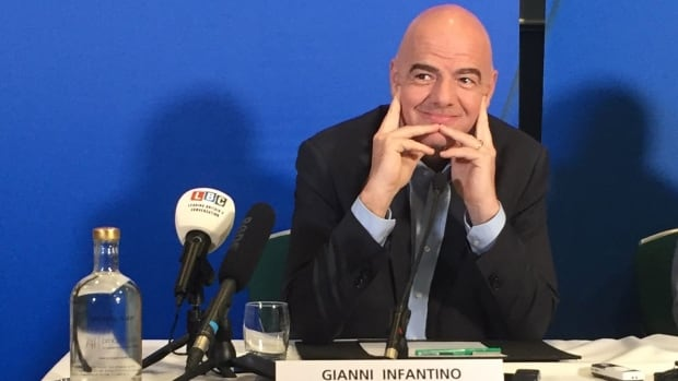 FIFA president Gianni Infantino listens to a question during a press conference in Cardiff, Wales, on Friday, March 4, 2016. The first week of Gianni Infantino's FIFA presidency is set to end with soccer further embracing technology once blocked by Sepp Blatter. Four years after the International Football Association Board approved technology to rule on disputed goals, the rule-making body is due to experiment with in-game video replay systems on Saturday at its annual meeting.