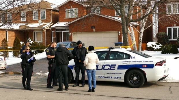 Police work at the scene of a stabbing in Mississauga that left a 19-year-old man in critical condition.