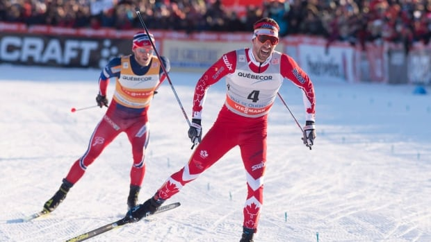 Alex Harvey powers past Norway's Martin Johnsrud Sundby near the finish of the men's pursuit race Saturday in Quebec City at the Ski Tour Canada's fourth stage.