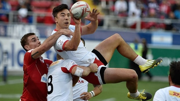 Nathan Hirayama of Canada grabs the ball during the USA Sevens Rugby tournament against Russia at Sam Boyd Stadium on Saturday in Las Vegas, Nevada.