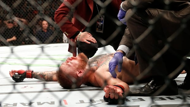 Conor McGregor recovers shortly after a second round-submission to Nate Diaz during their UFC 196 welterweight mixed martial arts match on Saturday, March 5, 2016, in Las Vegas.