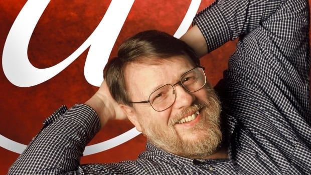 "An undated photo provided by Raytheon BBN Technologies shows Raymond Tomlinson. Tomlinson, the inventor of modern email and selector of the ""@"" symbol, has died."