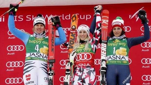 Austria's Eva-Maria Brem, centre, celebrates on the podium with Germany's Viktoria Rebensburg, left, and Italy's Federica Brignone.