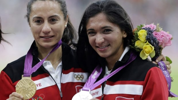 Gamze Bulut, right, seen with compatriot and gold medallist Asli Cakir Alptekin as they pose with their medals for the women's 1,500 metres at the 2012 Summer Olympics in London, are both facing bans for doping violations.