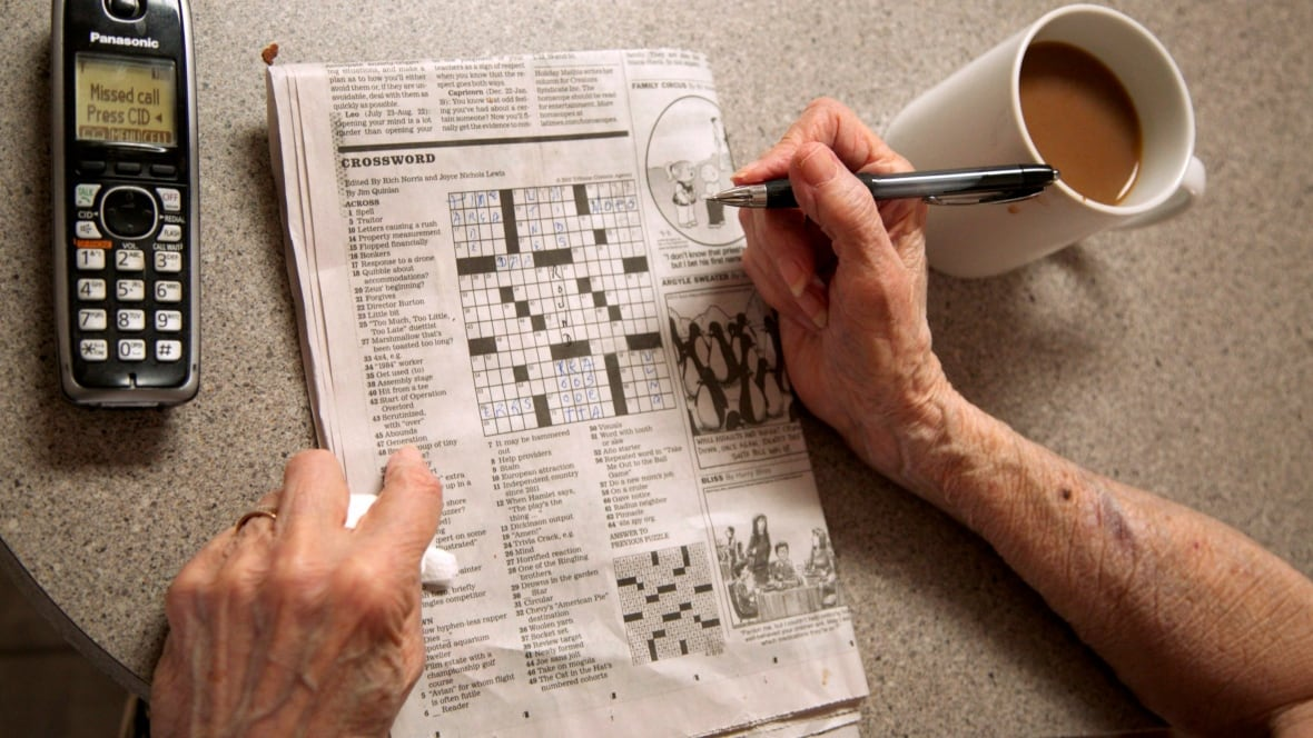 Where do I find the crossword puzzle in the Vancouver Province newspaper?