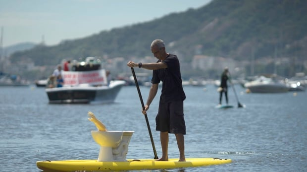 Rio Olympic organizers still have some work to do when it comes to cleaning up the water in Guanabara Bay. Fake toilets are spewing up fake yellow arms. Apparently this is a sign of gross pollution.