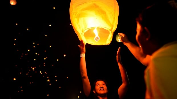 People release sky-lanterns on the eve of International Women's Day in Manila on March 7, 2016.