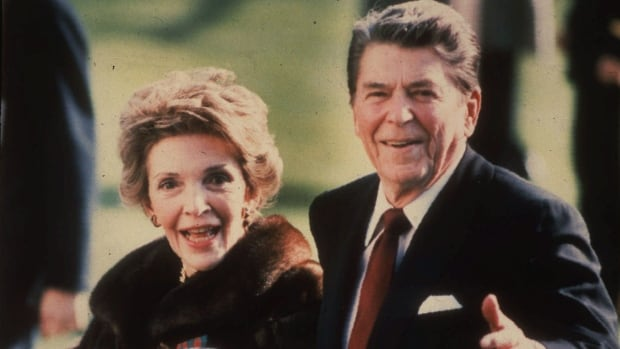 This December 1986, file photo shows first lady Nancy Reagan and President Ronald Reagan during a walk on the White House South lawn.